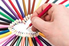 A mão está escrevendo com um lápis Imagens de Stock