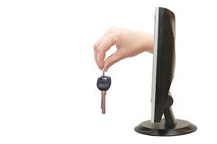 Mão fêmea com chaves do monitor Fotografia de Stock Royalty Free