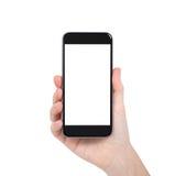 Mão fêmea isolada que guarda um telefone com tela branca foto de stock