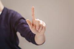 Mão fêmea nova para selecionar sobre ou tocar em algo Imagem de Stock Royalty Free