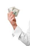 A mão fêmea prende o dinheiro imagens de stock