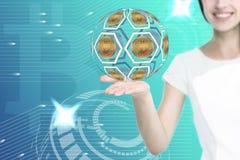 Mão fêmea que guarda ícones do bitcoin fotografia de stock