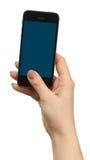 Mão fêmea que guarda um telefone Imagem de Stock