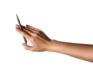 Mão fêmea que guarda uma pena como um ponteiro em um fundo branco Foto de Stock Royalty Free