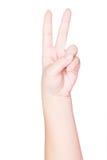 Mão fêmea que guardara dois dedos Fotografia de Stock Royalty Free