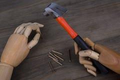 A mão guardara um martelo Imagens de Stock Royalty Free