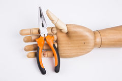 Mão guardarando alicates Imagem de Stock Royalty Free
