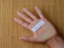 A mão humana com a palavra ajuda-me fotos de stock royalty free