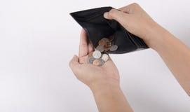 Mão humana e carteira vazia - quebrou Fotografia de Stock Royalty Free