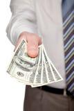 Mão humana que alcança para fora o dinheiro Fotos de Stock