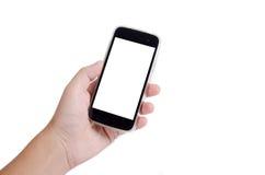 Mão humana que guarda o telefone esperto no fundo branco foto de stock royalty free