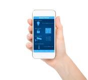 Mão isolada da mulher que guarda o telefone com a casa esperta do sistema foto de stock