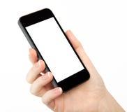 Mão isolada da mulher que guardara o telefone imagem de stock