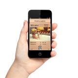 Mão isolada da mulher que guardara o telefone com uma carteira e um a móveis foto de stock royalty free