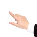 A mão isolada de um homem de negócios mostra o sentido imagem de stock royalty free