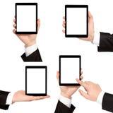 Mão isolada do homem de negócios que guarda o tablet pc fotografia de stock royalty free