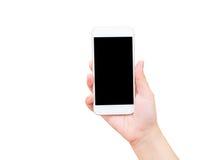 Mão isolada que guarda o telefone celular Imagens de Stock