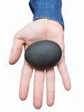 Mão isolada que guarda a pedra Foto de Stock Royalty Free