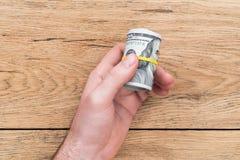 Mão masculina com dólares imagem de stock royalty free