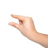 Mão masculina isolada que guardara um objeto foto de stock