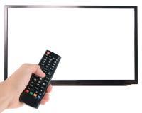 Mão masculina que guarda de controle remoto à tela da tevê isolada no branco Foto de Stock