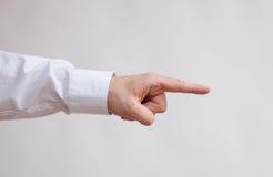 Mão masculina que indica lateralmente foto de stock royalty free