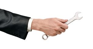 Mão masculina que mantém uma chave inglesa de prata isolada no fundo branco imagens de stock royalty free