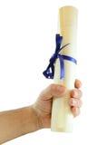 Mão com diploma fotografia de stock