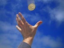 Mão/moeda Imagens de Stock