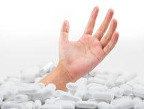 Mão na droga Foto de Stock