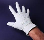 Mão na luva médica Foto de Stock