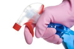 Mão na luva que prende um frasco do pulverizador do líquido de limpeza Imagens de Stock