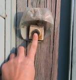 Mão no interruptor velho foto de stock