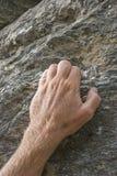 Mão no punho da rocha foto de stock royalty free