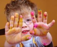 Mão pequena do artista Imagem de Stock