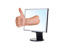 Mão (polegar) e ecrã de computador Foto de Stock Royalty Free