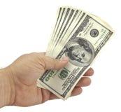 A mão prende as contas de cem-dólar Imagens de Stock