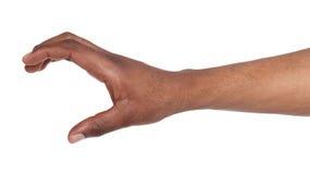 Mão preta que guardam o cartão de crédito ou outro isolada Imagens de Stock Royalty Free