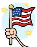 Mão que acena uma bandeira dos EUA e que acena a Imagens de Stock