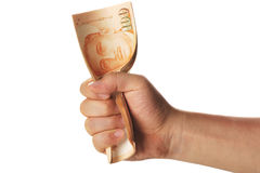 Mão que agarra uma pilha de dólares de singapore Fotografia de Stock Royalty Free