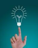 Mão que aponta à ampola da idéia Imagem de Stock Royalty Free