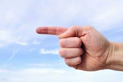 Mão que aponta à esquerda Fotos de Stock Royalty Free
