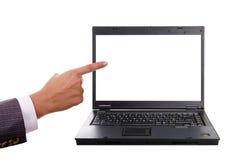 Mão que aponta a um portátil Foto de Stock Royalty Free
