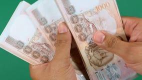 Mão que conta o dinheiro do dinheiro (jogo do laço) filme