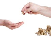 Mão que dá a 10 a moeda eurocent Imagem de Stock Royalty Free