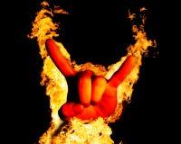 Mão que dá a rocha no fogo no preto foto de stock royalty free