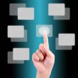 Mão que empurra em uma tela de toque Imagem de Stock