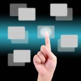 Mão que empurra em uma tela de toque Fotografia de Stock
