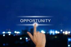 Mão que empurra o botão da oportunidade no tela táctil Fotografia de Stock Royalty Free