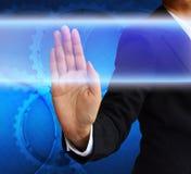 Mão que empurra o botão em uma relação do tela táctil foto de stock royalty free